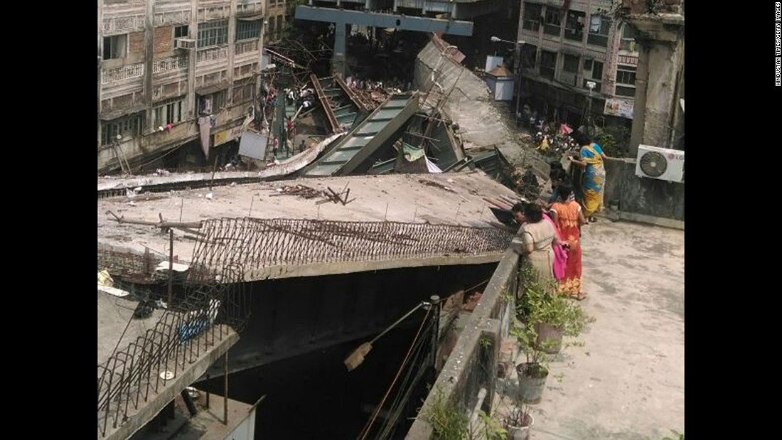 People look at the collapsed overpass. India's army and the National Disaster Response Force sent teams to the site.