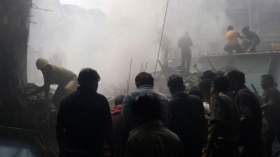 """People work to clear debris and search for missing people on March 31. """"My thoughts and prayers are with the families of those who lost their lives in Kolkata. May the injured recover at the earliest,"""" Indian Prime Minister Narendra Modi said."""