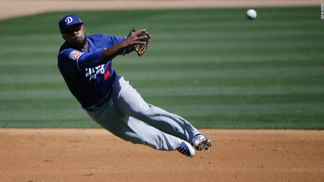 Los Angeles Dodgers second baseman Howie Kendrick throws to first base during a game in Phoenix on March 19.