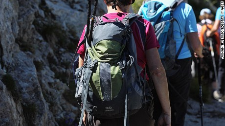 Tourists wear a rucksack are going down a hiking trail to the Kreuzeck pasture on August 19, 2012 near Garmisch-Partenkirchen, Germany. The German Alps especially around Garmisch-Partenkirchen and Germany's highest mountains the Zugspitze are one of Germany's most attractive destinations during the summer travel season. Currently a warm and dry weather period makes mountaineering and connected leisure activities even more appealing for domestic and foreign tourists. (Photo by Johannes Simon/Getty Images)