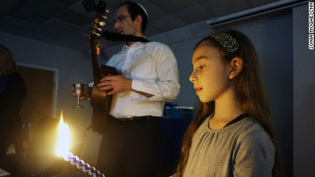 Rabbi Menashe East, shown with his daughter Ayala, hired Kagedan at Mount Freedom Jewish Center.