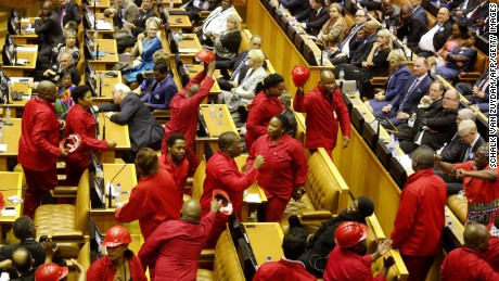 Members of the Economic Freedom Fighters party walk out of Parliament as President Jacob Zuma delivered his state of the nation address in February.