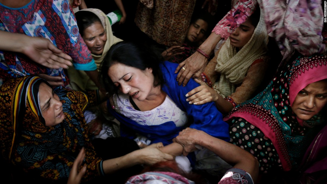 "Women try to comfort a mother whose son was killed in a bombing in Lahore, Pakistan, on Sunday, March 27.  A splinter group of the Pakistani Taliban claimed responsibility for <a href=""http://www.cnn.com/2016/03/29/world/gallery/pakistan-bombing-aftermath/index.html"" target=""_blank"">the deadly attack,</a> saying it had targeted Christians."