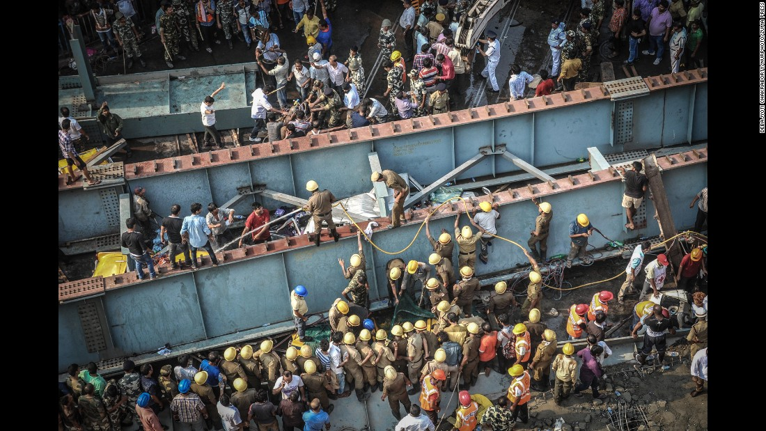 "Rescue workers and volunteers try to free people who are trapped under <a href=""http://www.cnn.com/2016/03/31/world/gallery/kolkata-overpass-collapse/index.html"" target=""_blank"">a collapsed overpass</a> in Kolkata, India, on Thursday, March 31. More than a dozen people are dead and many more are missing after the overpass, which was under construction, collapsed in a congested area of the city."