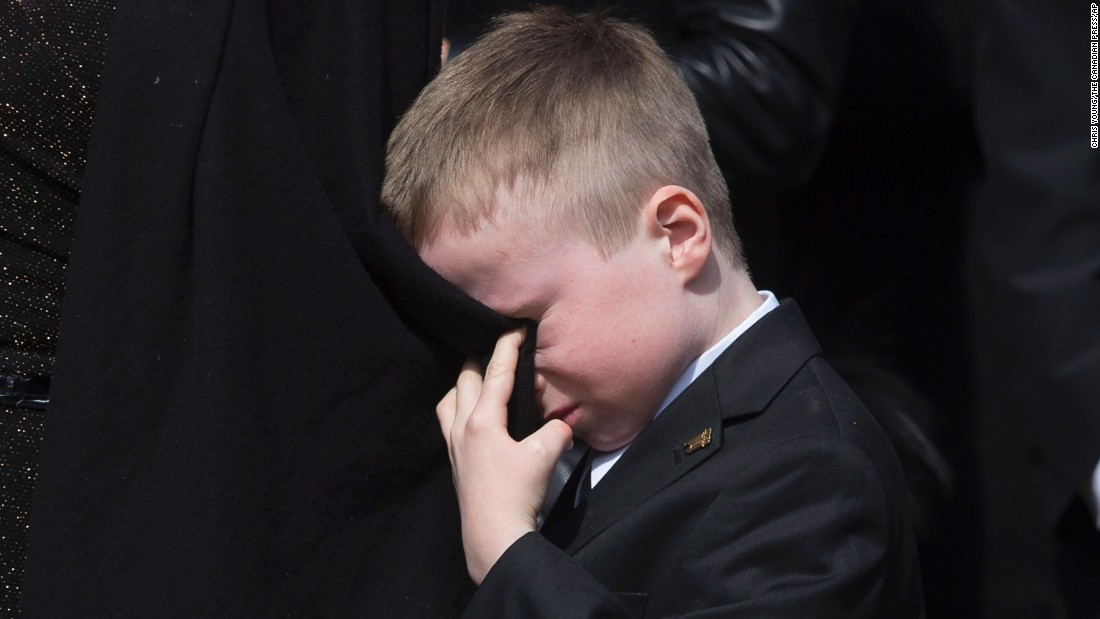 "Doug Ford cries into his mother's coat as he watches the casket of his father, former Toronto Mayor Rob Ford, being placed into a hearse on Wednesday, March 30. Rob Ford <a href=""http://www.cnn.com/2016/03/22/us/rob-ford-dies/"" target=""_blank"">died of cancer</a> at the age of 46."