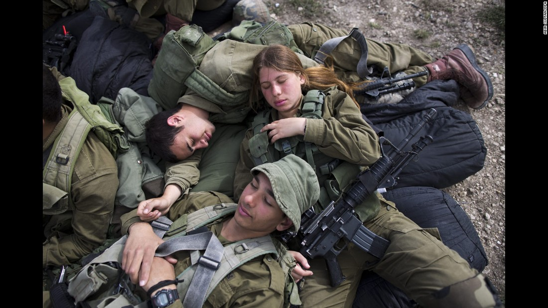 "Israeli soldiers rest during an exercise near Regavim, Israel, on Tuesday, March 29. The infantry battalion ""Bardelas"" (""Cheetah"") recently became the third Israeli army battalion to let women fight alongside men."