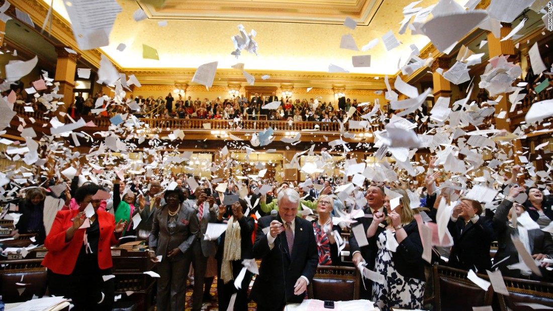 Members of the Georgia House of Representatives throw papers in the air on Friday, March 25 -- the final day of the General Assembly in Atlanta.