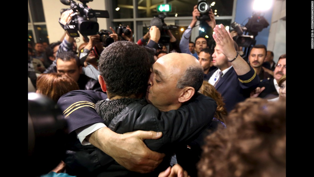 "Hazem Abu Bakr, a crew member of a <a href=""http://www.cnn.com/2016/03/29/europe/hijacked-egypt-air-jet/index.html"" target=""_blank"">hijacked EgyptAir flight,</a> embraces a passenger, left, after they arrived at Cairo International Airport on Tuesday, March 29. A man who officials described as ""unstable"" held the plane hostage with a fake explosive belt, forcing it to divert to Cyprus. The incident ended peacefully and the authorities took the hijacker into custody."