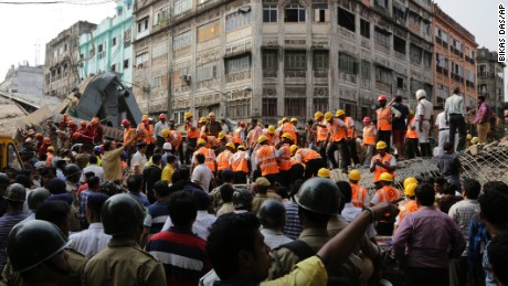 Indian rescue workers work on a partially collapsed overpass in Kolkata, India,Thursday, March 31, 2016. A long section of a road overpass under construction collapsed Wednesday in a crowded Kolkata neighborhood, with tons of concrete and steel slamming into midday traffic, killing several and injuring many. (AP Photo/Bikas Das)