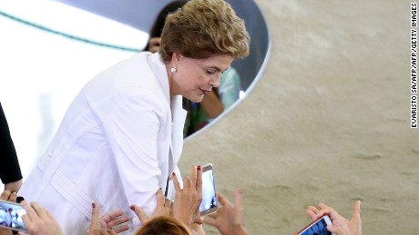 Brazilian President Dilma Rousseff is greeted by people at the end of the launching ceremony of the third phase of the state-subsidized housing program at Planalto Palace in Brasilia on March 30, 2016. In the midst of a political and economic crisis and the prediction of a deficit of almost 100 billion Reais (around U$ 27,4 Billion) in the budget this year, the government launches a program that foresees the construction of two million houses until 2018. AFP PHOTO/EVARISTO SA / AFP / EVARISTO SA        (Photo credit should read EVARISTO SA/AFP/Getty Images)