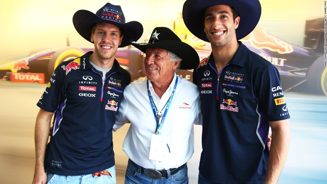 Andretti posing with Sebastian Vettel of Daniel Ricciardo at Monza in 2014 when the pair were teammates at Red Bull Racing. Andretti says F1 is in good hands despite controversies over recent rule changes to qualifying.