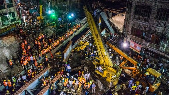 Rescue workers and volunteers work through the night to free people who got trapped under a collapsed overpass in Kolkata, India, on Thursday, March 31. At least 24 people were killed.