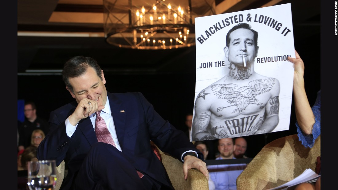 U.S. Sen. Ted Cruz, a Republican presidential candidate, laughs at a poster while speaking a town-hall event in Madison, Wisconsin, on Wednesday, March 30.