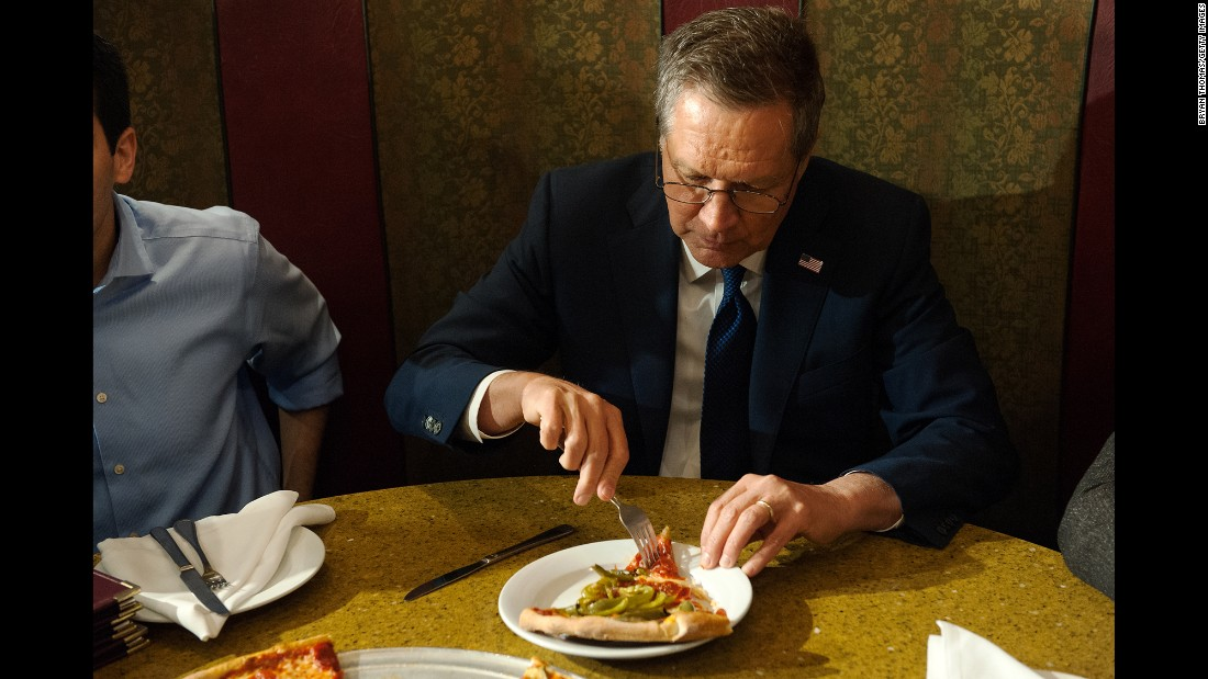 "Ohio Gov. John Kasich eats a slice of pizza in New York on Wednesday, March 30. The Republican presidential candidate <a href=""http://www.cnn.com/2016/03/31/politics/kasich-eats-pizza-with-a-fork/"" target=""_blank"">caught some flak</a> over using the utensil, but he defended himself the next day during an interview with Robin Roberts on ABC's ""Good Morning America."" ""The pizza came scalding hot, OK?"" Kasich said."