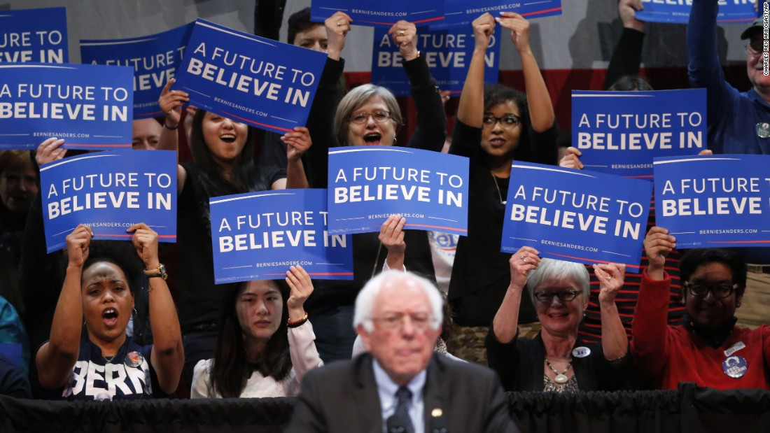 Supporters of U.S. Sen. Bernie Sanders cheer for the presidential candidate as he speaks in Appleton, Wisconsin, on Tuesday, March 29.