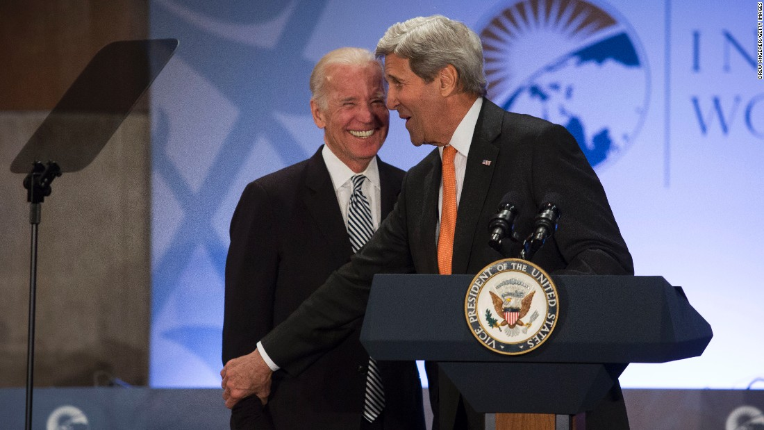 U.S. Vice President Joe Biden, left, laughs as Secretary of State John Kerry introduces him Tuesday, March 29, at the International Women of Courage Forum in Washington.