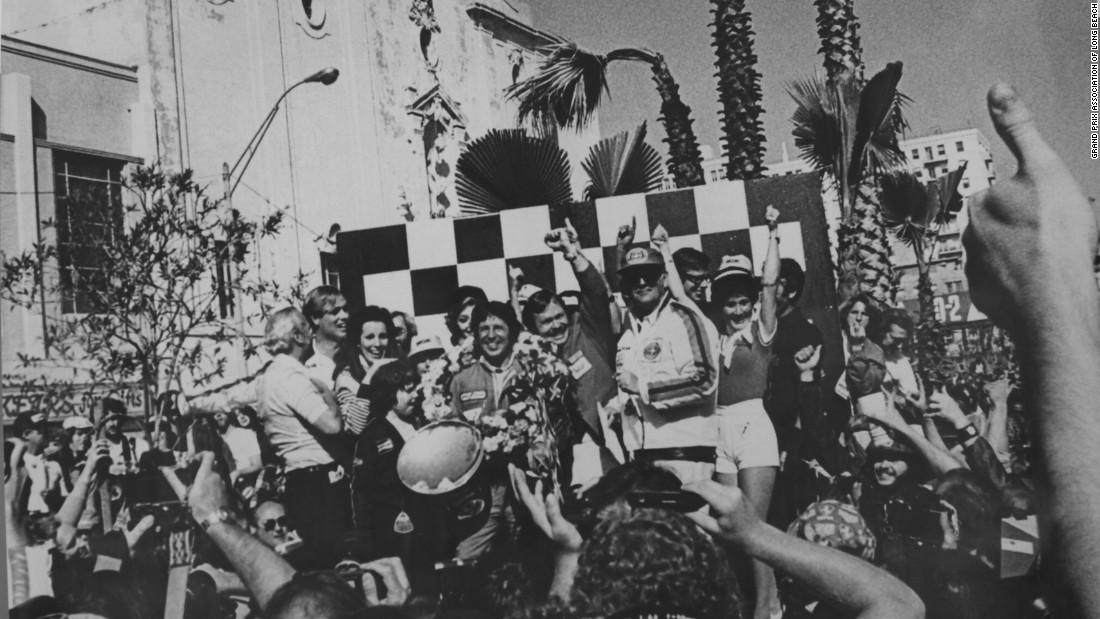 Happy days! Mario Andretti celebrates his win at the 1977 United States GP West at Long Beach. It was one of 12 victories Andretti achieved in Formula One.