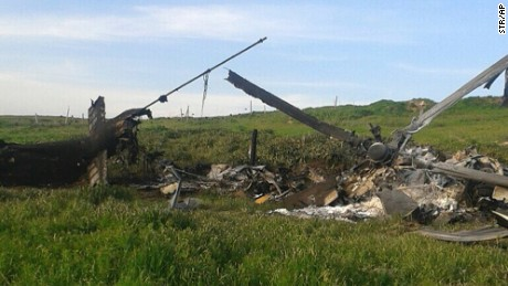 "Remains of a downed Azerbaijani forces helicopter lies in a field in the separatist Nagorno-Karabakh region, on Saturday, April 2, 2016.  In a statement, Azerbaijan's Defense Ministry said 12 of its soldiers ""became shards"" (Muslim martyrs) and said one of its helicopters was shot down.  At least 30 soldiers and a boy were reported killed as heavy fighting erupted Saturday between Armenian and Azerbaijani forces over the separatist region of Nagorno-Karabakh. (AP Photo)"