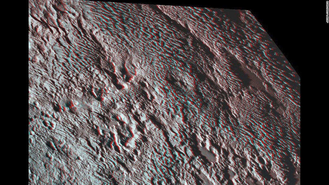 "New Horizons photographed what scientists are calling ""bladed"" terrain near the heart-shaped region of the dwarf planet. This 3-D image was created using two images taken about 14 minutes apart on July 14. The first image was snapped about 16,000 miles (25,000 kilometers) from Pluto and the second was taken when the spacecraft was 10,000 miles (about 17,000 kilometers) away. Break out your 3-D glasses for the best view."