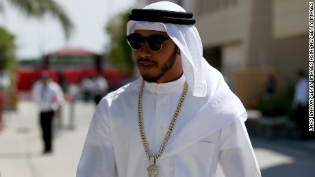 Lewis Hamilton walks through the paddock in Arabic dress ahead of the 2016 Bahrain F1 Grand Prix.