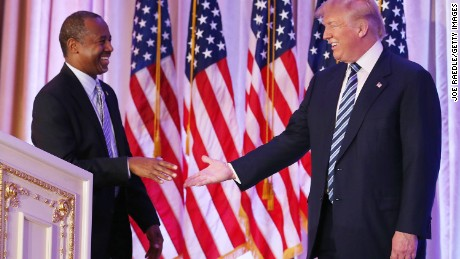 Republican presidential candidate Donald Trump shakes hands with former presidential candidate Ben Carson as he receives his endorsement at the Mar-A-Lago Club on March 11, 2016 in Palm Beach, Florida.