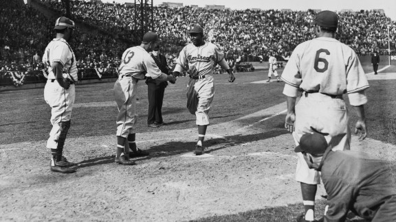 Robinson crosses home plate after hitting a three-run home run for the Montreal Royals in 1946.