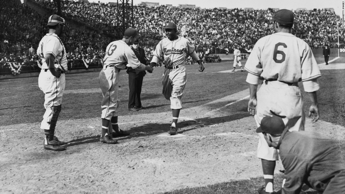Robinson was born in Cairo, Georgia, but raised in Pasadena, California. He was a formidable athlete, lettering in four sports at UCLA and leading the nation in rushing as a football player. After a short stint in baseball's Negro Leagues, he signed a contract with the Dodgers organization and spent his first season with its Montreal Royals farm club. Here, he crosses home plate after hitting a three-run home run on Opening Day 1946.