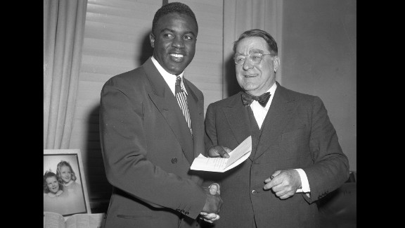 Dodgers executive Branch Rickey eyed Robinson as the right man to break the color line and signed him to his first major league contract. The two are shown here in 1950.