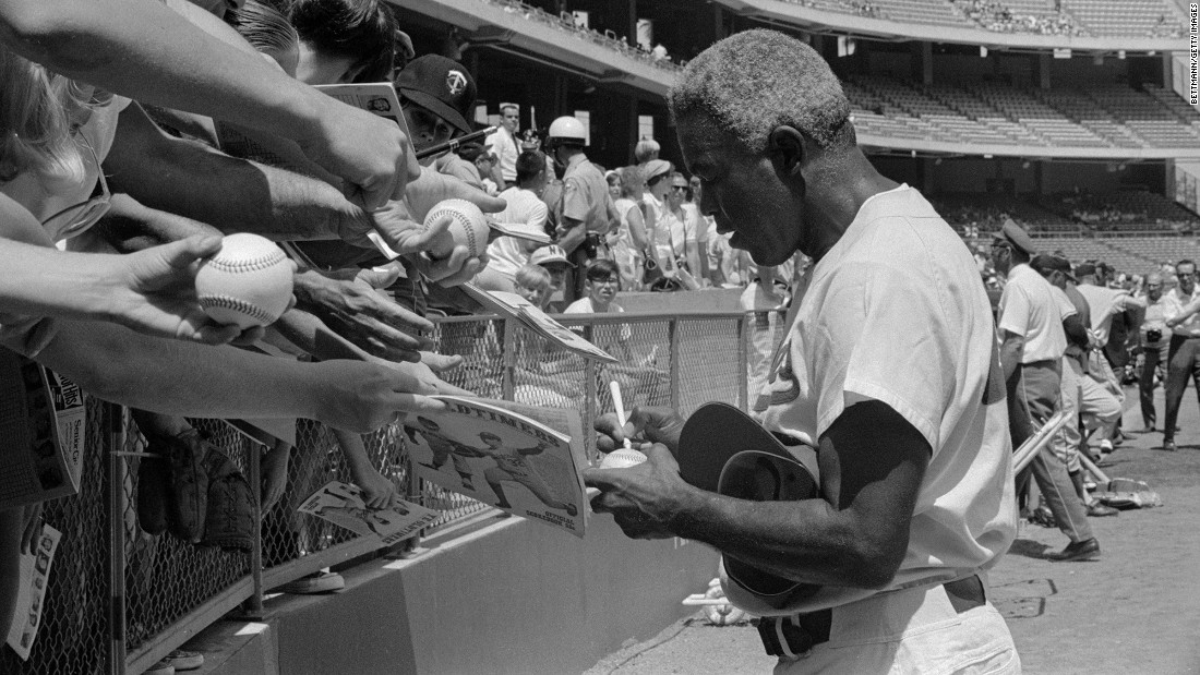 Robinson signs autographs before the start of the Old Timers Game between the Angels and Dodgers at Anaheim Stadium in 1969. Three years later, he died of a heart attack at age 53. His legacy lives on in countless ways: His number has been retired by every baseball team, and Jackie Robinson Day is celebrated every April 15 in honor of his first day in the majors. Rachel Robinson founded the Jackie Robinson Foundation, which gives scholarships and leadership training to minority youths, in 1973.