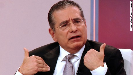 TOPSHOT - Ramon Fonseca, one of the founders of Panama's Mossack Fonseca law firm, gestures during a TV interview with Telemetro, in Panama City on April 4, 2016. A massive leak -coming from Mossack Fonseca- of 11.5 million tax documents on Sunday exposed the secret offshore dealings of aides to Russian president Vladimir Putin, world leaders and celebrities including Barcelona forward Lionel Messi. An investigation into the documents by more than 100 media groups, described as one of the largest such probes in history, revealed the hidden offshore dealings in the assets of around 140 political figures -- including 12 current or former heads of states.  AFP PHOTO/ CORTESIA TELEMETRO / AFP / TELEMETRO PANAMA / STR        (Photo credit should read STR/AFP/Getty Images)