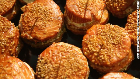 BERLIN, GERMANY - JANUARY 16:  Smoked salmon patties covered with sesame seeds lie on display at a stand at the International Green Week agricultural trade fair (Internationale Gruene Woche) on January 16, 2015 in Berlin, Germany. The International Green Week is the world's largest agricultural trade fair and is open to the public from January 16-25.  (Photo by Sean Gallup/Getty Images)