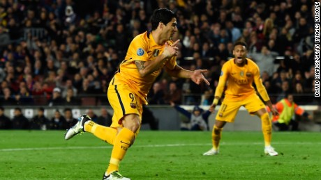 Luis Suarez celebrates after scoring the decisive second goal for Barcelona in the Nou Camp.