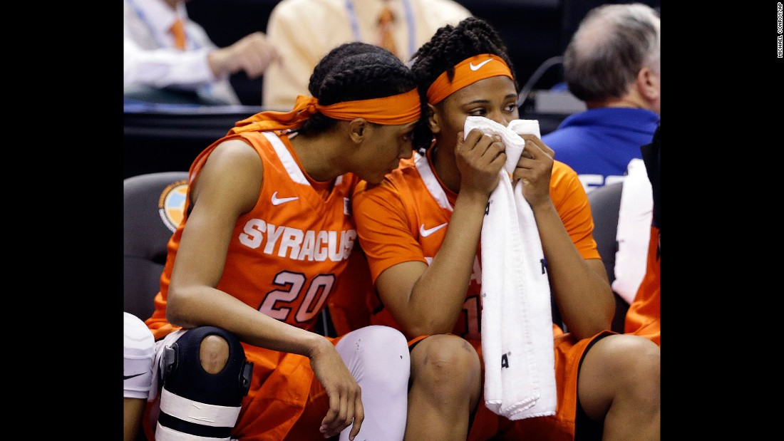 Syracuse's Brittney Sykes, left, and teammate Cornelia Fondren sit on the bench during the second half of the game.