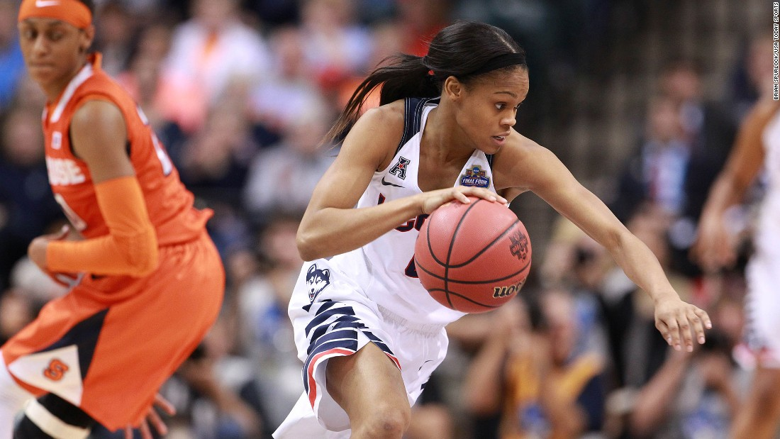 Connecticut guard Moriah Jefferson dribbles the ball past Syracuse guard Brittney Sykes.