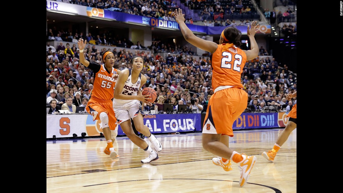 Connecticut's Napheesa Collier goes to the basket against Syracuse's Bria Day, left, and Taylor Ford.