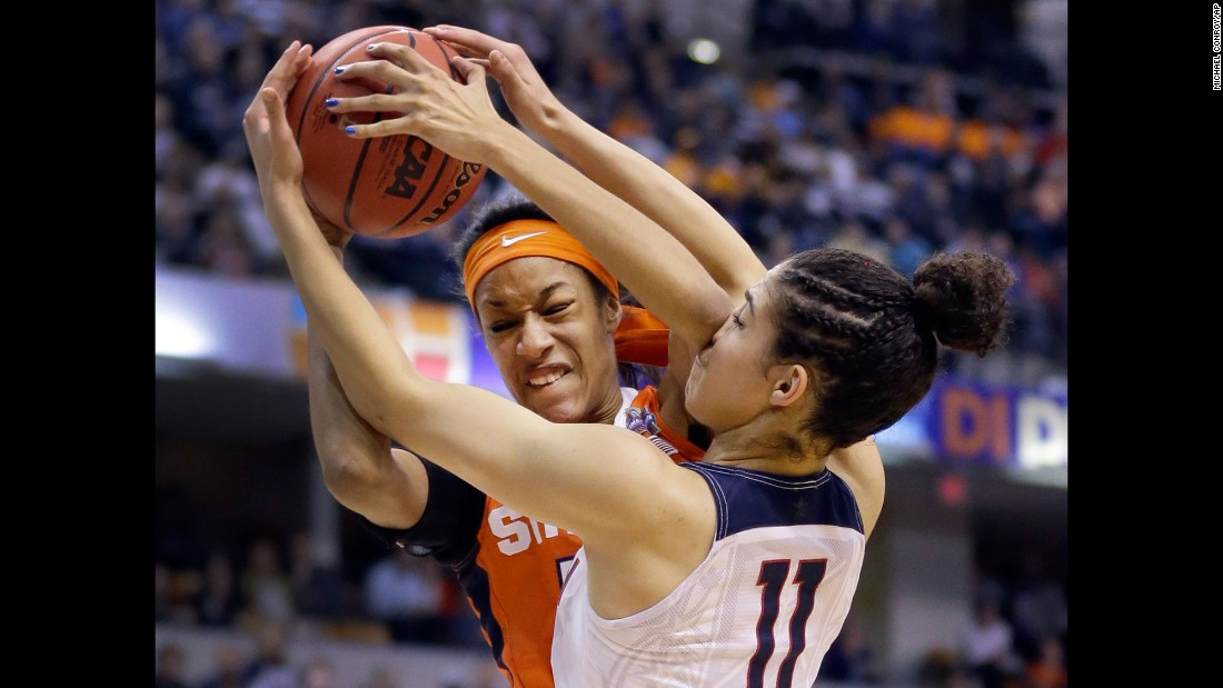 Syracuse's Briana Day and Connecticut's Kia Nurse battle for a rebound.