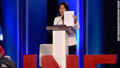 Peruvian presidential candidate for the Fuerza Popular (Popular Force) party, and daughter of imprisoned former Peruvian President (1990-2000) Alberto Fujimori, Keiko Fujimori, shows a political commitment signed by her as she participates in a televised debate organized by the Peruvian National Electoral Jury in Lima on April 3, 2016. Fujimori leads the polls for next April 10 elections in Peru. AFP PHOTO/CRIS BOURONCLE / AFP / CRIS BOURONCLE        (Photo credit should read CRIS BOURONCLE/AFP/Getty Images)