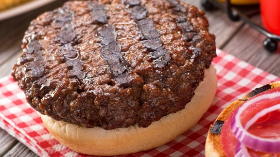 Hamburgers are a summer classic, the go-to cookout food. A typical burger patty and bun will be about 390 calories. To work that off, a 35-year-old, 150-pound person would need to spend about 30 minutes on an elliptical machine.