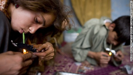 KABUL, AFGHANISTAN - AUGUST 27:  Gulparai, 12, (L) smokes heroin along side her mother Sabera and brother Zaher, 14, (R) August 27, 2007 in Kabul, Afghanistan. Gulparai's mother, Sabera, a widow, has been smoking for four years since she lost her husband. Her children, Gulparai and Zaher began smoking two years ago after watching their mother. The cost for daily use of the drug is around $3.00 USD or 150 in Afghani currency. Farmers in the Taliban-held areas of the south are also urged to grow opium. Although there are around 35,000 NATO troops in Afghanistan, the drug trade has increased, with Afghanistan producing 95 percent of the world's poppies. According to the UN Office on Drugs and Crime (UNODC), the opium production in 2006 increased 57 percent from 2005, with an additional 15% jump in 2007 despite a $600 million counter narcotics effort by the U.S.  (Photo by Paula Bronstein/Getty Images)