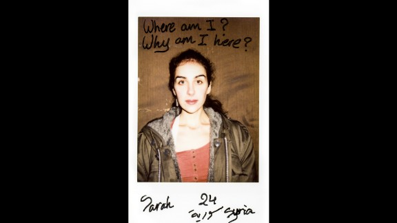 """""""Where am I? Why am I here?"""" asks Sarah, a 24-year-old Syrian refugee who was recently photographed by Charlotte Schmitz. Schmitz used a Polaroid camera so her subjects could write their thoughts directly onto the photos. """"Everyone could tell freely what he or she thinks or feels,"""" she said."""