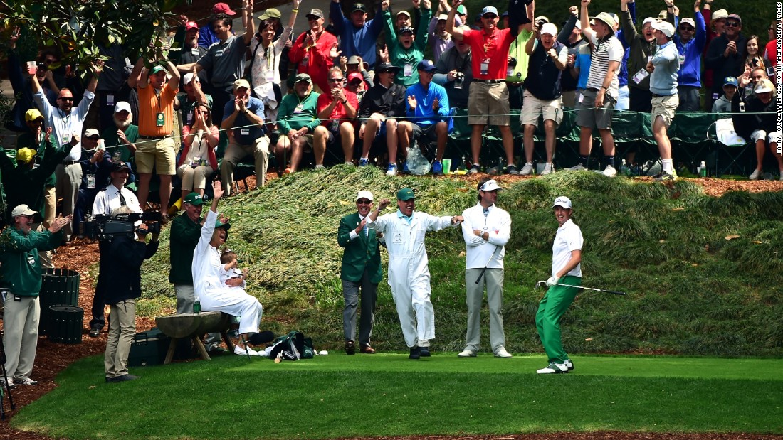 Webb Simpson of the United States celebrates with his caddie and the crowd after making a hole-in-one at the ninth. However, playing partner Bubba Watson looked far from impressed, perhaps the pair a hefty wager riding on the event?