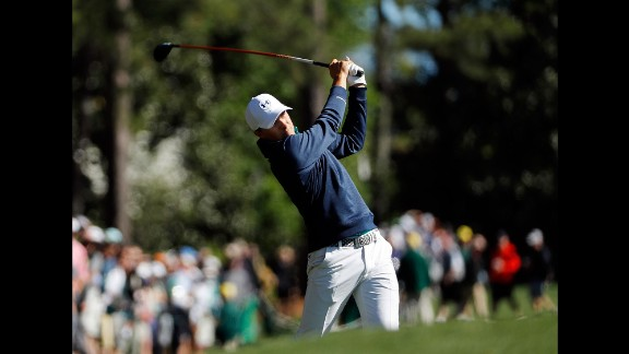 Spieth hits a shot during the first round on Thursday, April 7. Spieth shot a 6-under 66 to lead the tournament by two strokes heading into Friday.