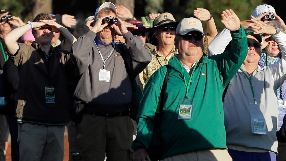 Spectators watch the ceremonial tee shots that were taken Thursday by legends Jack Nicklaus and Gary Player.