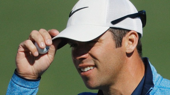 Paul Casey tips his cap after putting on the second hole Thursday.