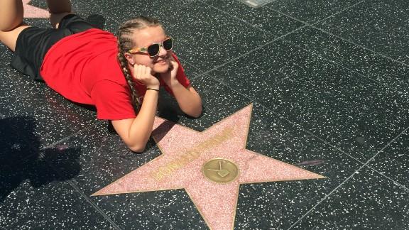 Many tourists enjoyed posing beside the Trump star.
