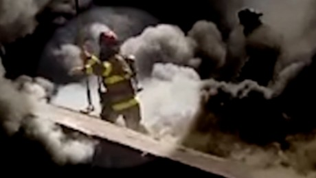 Firefighter falls through burning roof elam pkg_00000000.jpg