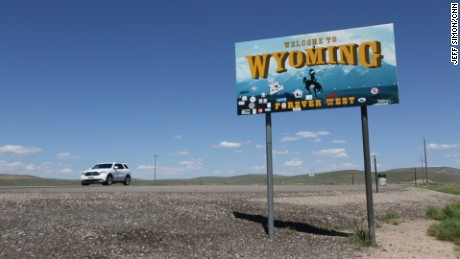 "A ""Welcome to Wyoming"" sign along a highway at the Utah-Wyoming border."