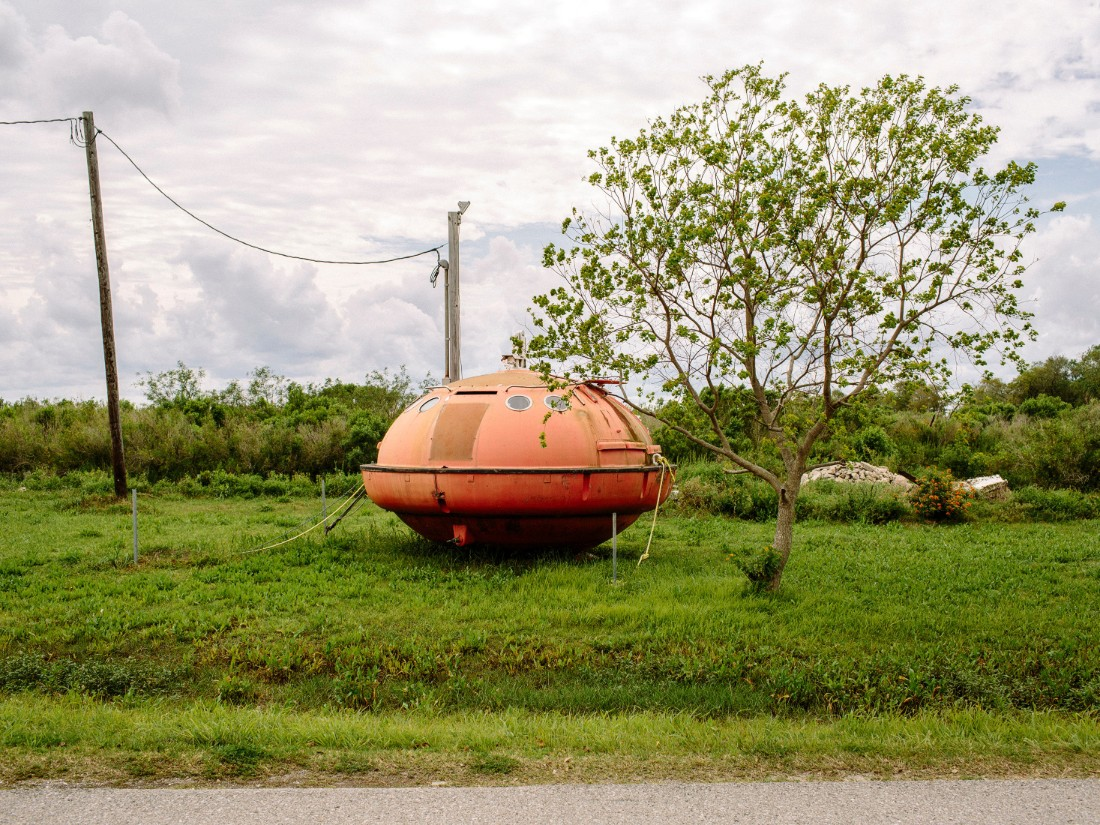 An evacuation pod from an oil rig sits in an empty lot on Island Road.