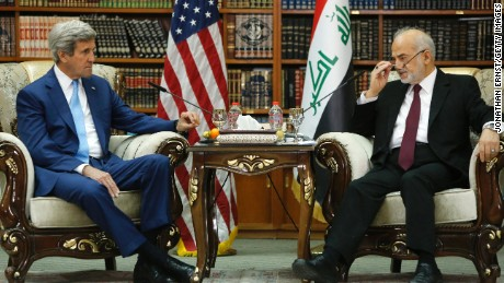 Iraq's Foreign Minister Ibrahim al-Jaafari receives U.S. Secretary of State John Kerry in the library at the foreign minister's villa in Baghdad on April 8, 2016.