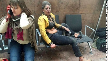 Two women sit at the Brussels airport in Zaventem following twin explosions on March 22.